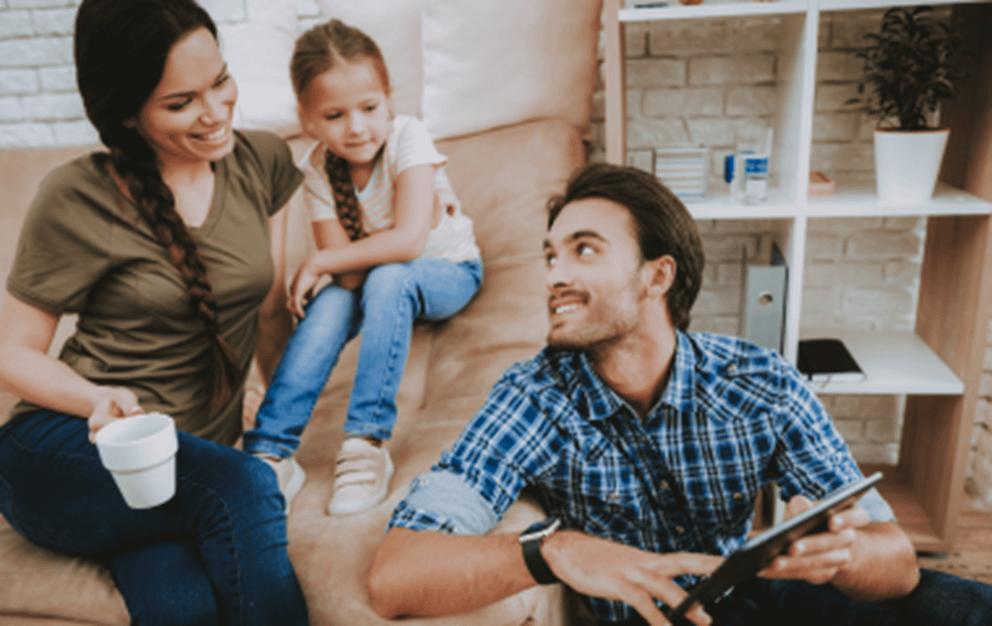 Family in living room talking.