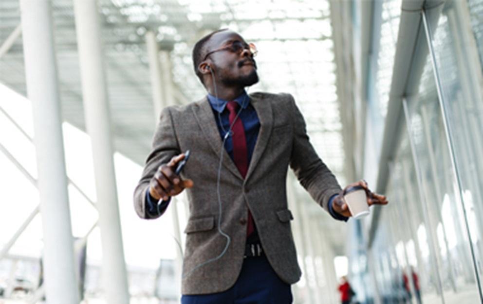 Man in suit listening to headphones