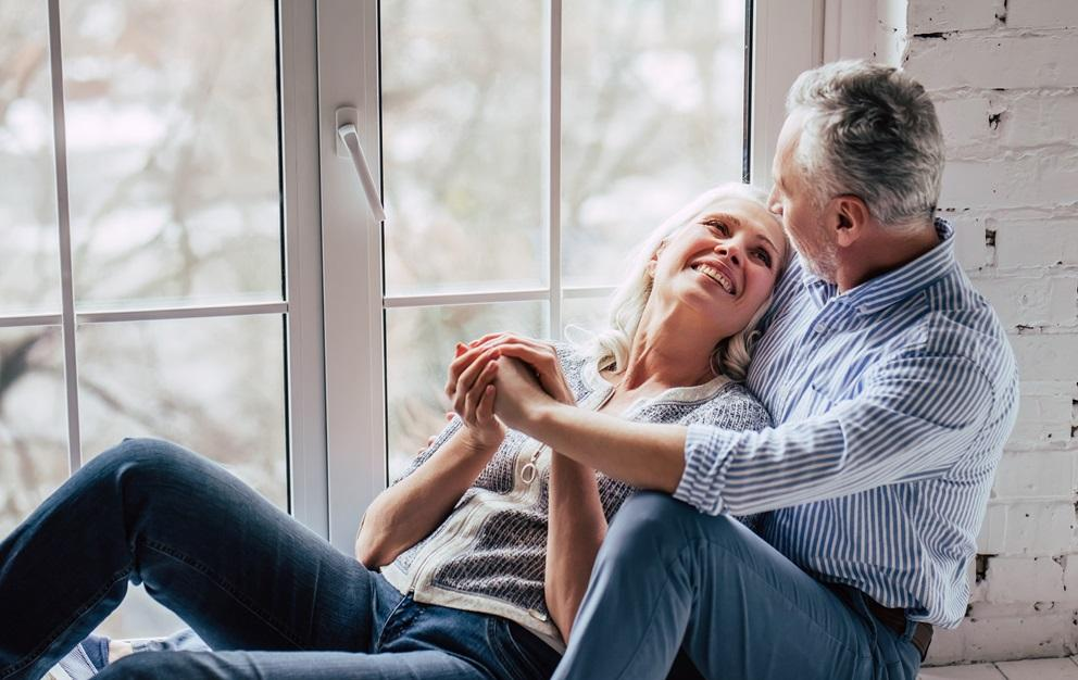 Couple sitting together on a windowsill