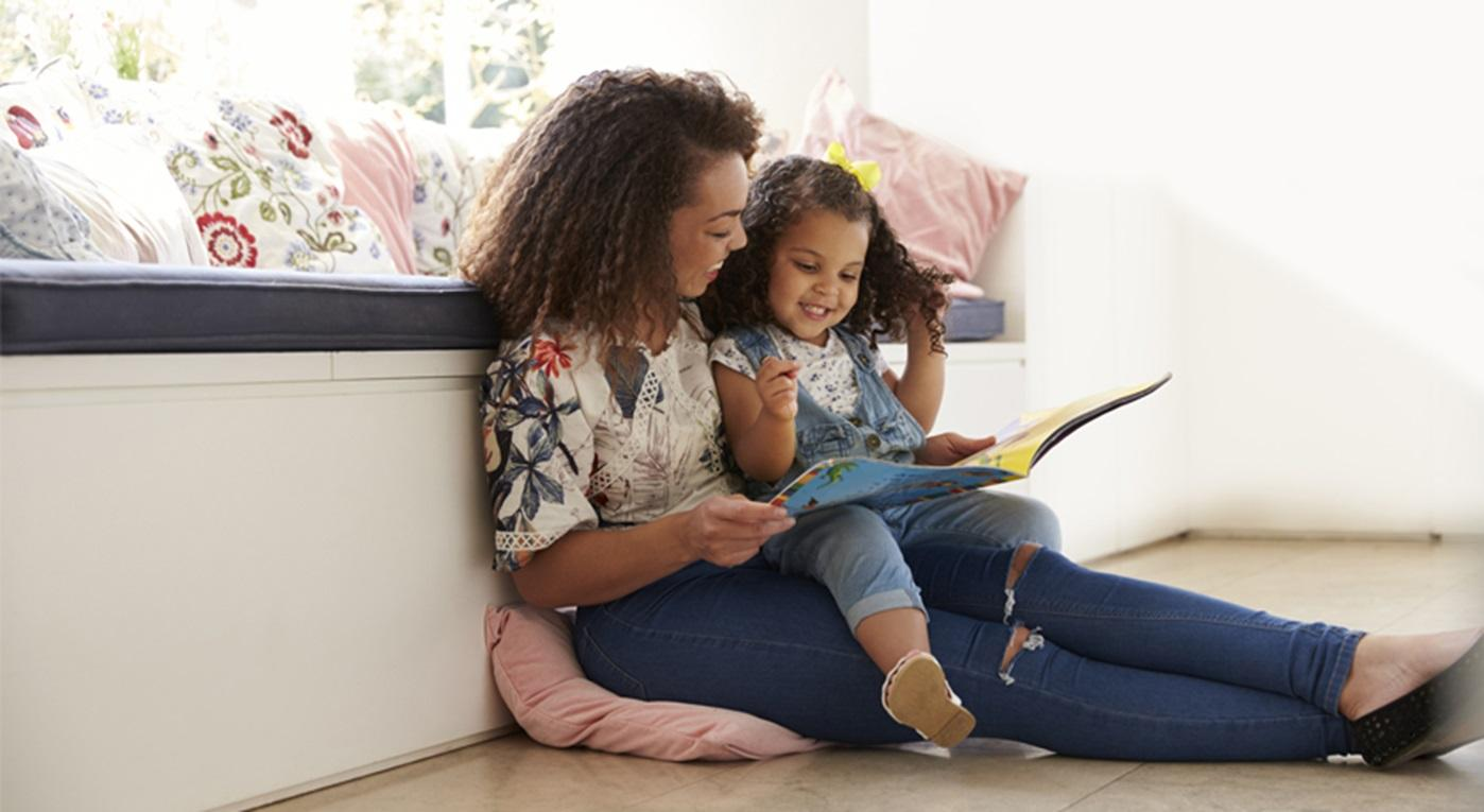 Mother reading with her toddler.
